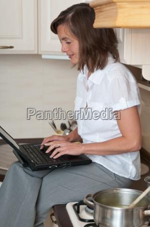 multitasking preparing meal and working