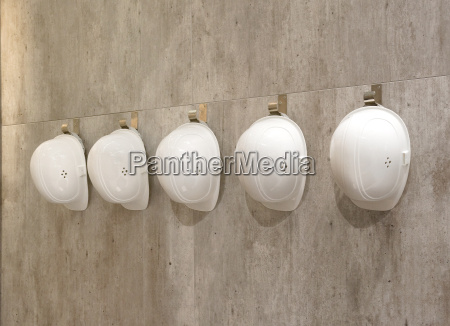 protective helmets on a wall