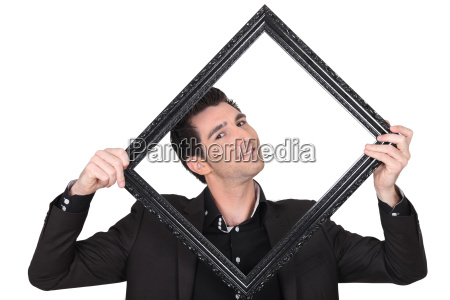 man in suit carrying frame on