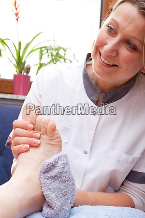 nurse washes a patients foot