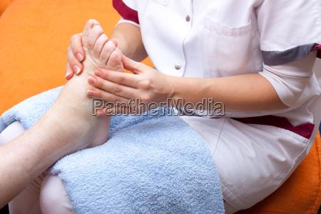nurse treats a patients foot