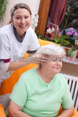 nurse massages a patients head