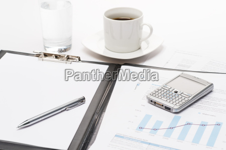 business notepad phone and cup of