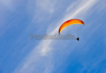 winter mountains and paragliding with sky