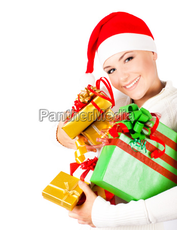 happy santa girl holding christmas gifts