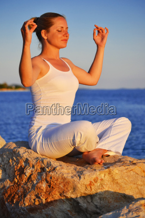 young woman during yoga meditation on