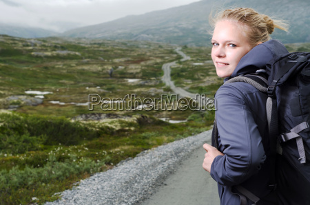 young blonde woman while hiking