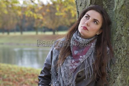 thinking woman at tree