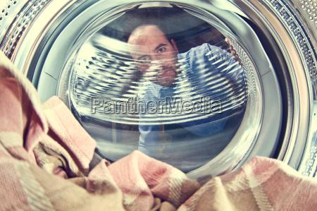 man and washing machine