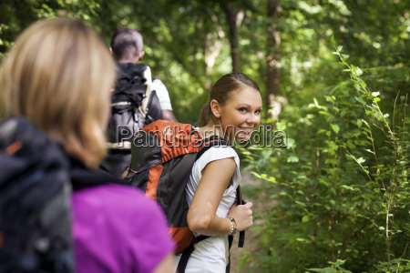 people with backpack doing trekking in