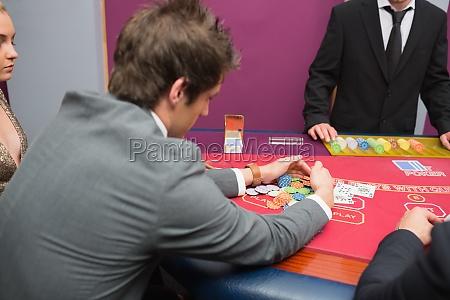 man taking the pot in poker