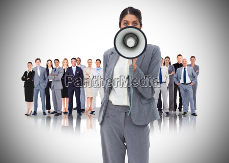 businesswoman with megaphone standing in front