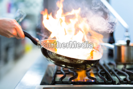 cooking in restaurant kitchen at the