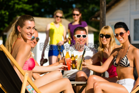 people at the beach while celebrating