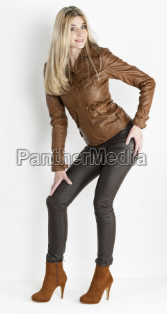 standing woman wearing brown clothes and