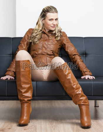woman wearing brown jacket and boots