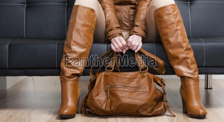 detail of sitting woman in brown