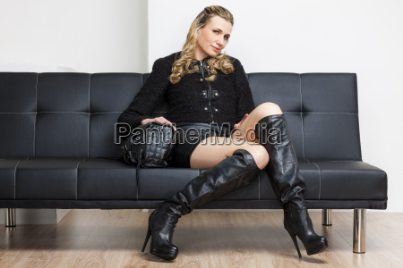 woman wearing black clothes and boots