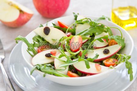 apple with raisin and rocket salad