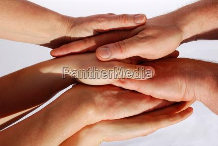 many hands symbolizing unity and teamwork