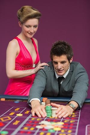 man taking his winnings at the
