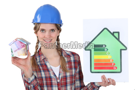 female heating engineer holding money box