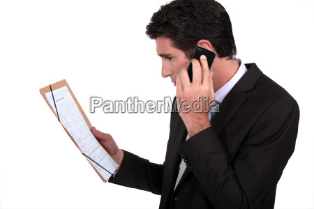 businessman on the phone discussing with