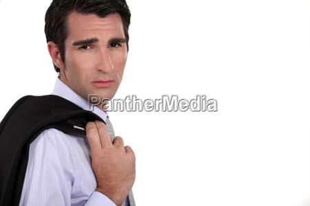serious man in suit holding his
