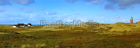 panorama with frisian house and lighthouse