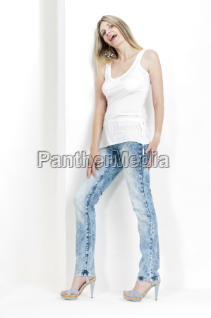 standing woman wearing jeans and summer