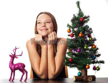 woman deer and a christmas tree