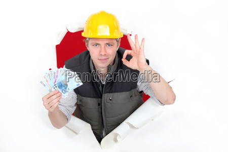 craftsman holding money and making an