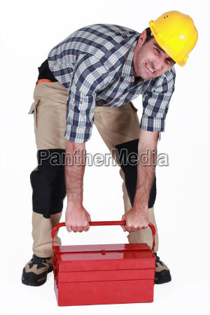 builder struggling to lift heavy tool
