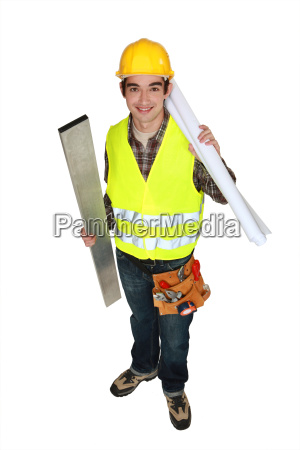 portrait of young carpenter holding steel