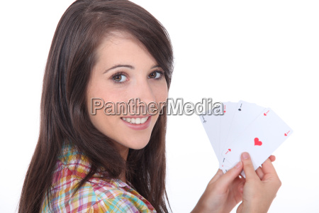young brunette with poker cards