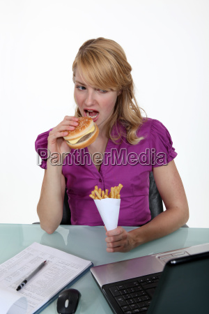 woman eating junk food at her