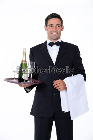 smart waiter holding tray of champagne
