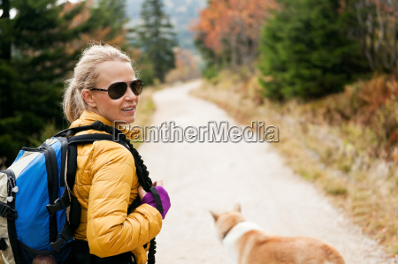 woman hiking and reading map in