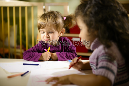 children and fun two preschoolers drawing