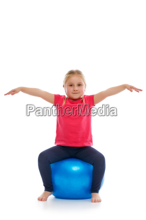 little girl doing fitness exercise with
