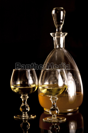 old decanter and glasses filled with