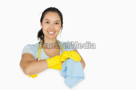 smiling woman in apron and rubber