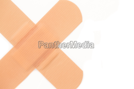 close up of two plasters crossing