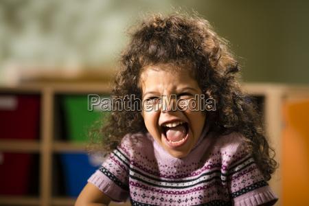 happy female child smiling for joy