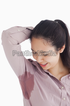 distressed woman looking at sweat patches