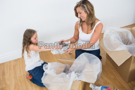 mother and daughter unpacking thing from