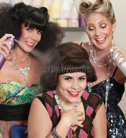 ladies play with hair spray