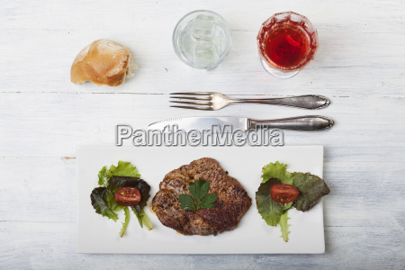 steak with bread and salad