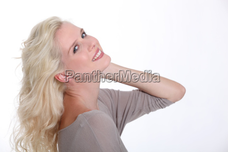 confident blond woman posing on a