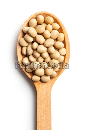 soy beans in wooden spoon